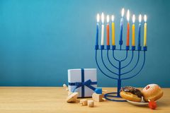 Jewish holiday Hanukkah background with menorah, sufganiyot, gif royalty free stock photography
