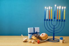 Jewish holiday Hanukkah background with menorah, sufganiyot, gif stock image
