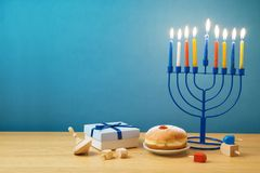 Jewish holiday Hanukkah background with menorah, sufganiyot, gif stock images
