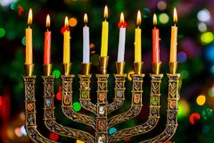 Jewish holiday Hanukkah background with menorah traditional candelabra and burning candles defocused bokeh,. Bokeh light, bokeh background Stock Photo