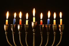 Jewish holiday Hanukkah background with menorah & x28;traditional candelabra& x29; and burning candles. Image of jewish holiday Hanukkah background with menorah Stock Photography