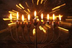 Jewish holiday Hanukkah background with menorah & x28;traditional candelabra& x29; and burning candles. Image of jewish holiday Hanukkah background with menorah Stock Image