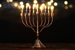 Jewish holiday Hanukkah background with menorah & x28;traditional candelabra& x29; and burning candles. Image of jewish holiday Hanukkah background with Royalty Free Stock Photo