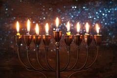 Jewish holiday Hanukkah background with menorah & x28;traditional candelabra& x29; and burning candles. Image of jewish holiday Hanukkah background with menorah Stock Photos