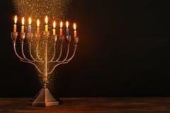 Jewish holiday Hanukkah background with menorah & x28;traditional candelabra& x29; and burning candles. Image of jewish holiday Hanukkah background with menorah Royalty Free Stock Images