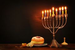 Jewish holiday Hanukkah background with traditional spinnig top, menorah & x28;traditional candelabra& x29; and burning candles. Image of jewish holiday Hanukkah royalty free stock photo