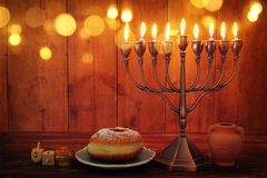 Jewish holiday Hanukkah background with traditional spinnig top, menorah & x28;traditional candelabra& x29; and burning candles. Image of jewish holiday Hanukkah stock images