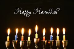 Jewish holiday Hanukkah background with traditional spinnig top, menorah & x28;traditional candelabra& x29; and burning candles. Jewish holiday Hanukkah stock image