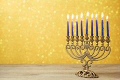 Jewish holiday Hanukkah background with vintage menorah over lights bokeh. Jewish Hanukkah holiday background with vintage menorah over lights bokeh Stock Photography
