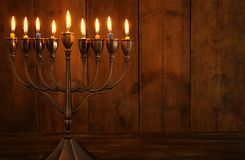Jewish Holiday Hanukkah Background With Traditional Spinnig Top, Menorah & X28;traditional Candelabra& X29; And Burning Candles. Royalty Free Stock Image