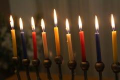 Jewish holiday Hanukkah candles in menorah Stock Photo
