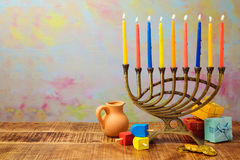 Jewish holiday Hanukkah celebration with menorah, dreidel, gifts and oil jug Royalty Free Stock Photos
