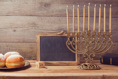 Jewish holiday Hanukkah celebration with vintage menorah and chalkboard with copy space Royalty Free Stock Photo
