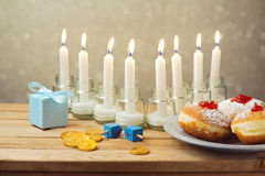 Jewish holiday Hanukkah celebration on wooden table Stock Photos