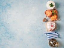 Jewish holiday Hanukkah concept background. Jewish holiday Hanukkah concept and background. Hanukkah food doughnuts and potatoes pancakes latkes, oil and