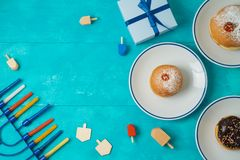 Jewish holiday Hanukkah concept with menorah, sufganiyot, gift b stock images