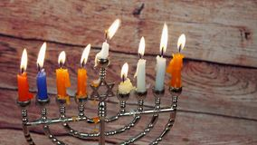 Jewish holiday Hanukkah creative background with menorah. View from above focus on . stock video footage