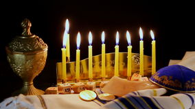 Jewish holiday Hanukkah creative background with menorah. View from above focus on . stock video