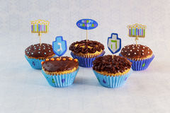 Jewish holiday Hanukkah cupcakes decorated. Jewish holiday Hanukkah cupcakes Gourmet cupcakes decorated with white and blue icing for Hanukkah Stock Photos