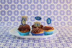 Jewish holiday Hanukkah cupcakes decorated with white and blue . Jewish holiday Hanukkah cupcake Gourmet cupcakes decorated with white and blue icing for Royalty Free Stock Photo