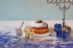 jewish holiday Hanukkah, donut and wooden dreidel Royalty Free Stock Photo