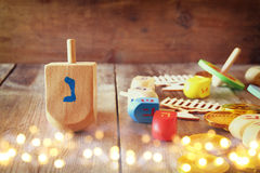 jewish holiday Hanukkah with dreidels (spinning top) and coins c Stock Image
