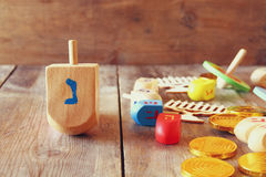 Jewish holiday Hanukkah with dreidels (spinning top) and coins c Stock Photography