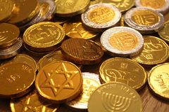 Jewish holiday Hanukkah with gold and silver chocolate coins. Symbol of menorah and star of David stock photo