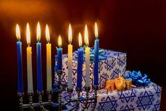 Jewish Holiday Hanukkah holiday with menorah burning candles. Stock Image