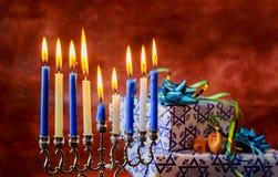 Jewish Holiday Hanukkah holiday with menorah burning candles. Royalty Free Stock Photography