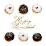 Jewish holiday Hanukkah image with traditional doughnuts isolated on white. Jewish holiday Hanukkah image with traditional doughnuts isolated on white Royalty Free Stock Photos