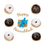 Jewish holiday Hanukkah image with traditional doughnuts isolated on white. Jewish holiday Hanukkah image with traditional doughnuts isolated on white Royalty Free Stock Photo