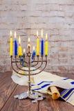 Jewish holiday Hanukkah with menorah over wooden background Stock Photo