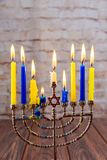 Jewish holiday Hanukkah with menorah over wooden background Royalty Free Stock Photography