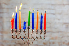 Jewish holiday Hanukkah with menorah over wooden background Royalty Free Stock Image