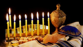 Jewish holiday Hanukkah with menorah over wooden table. Hanukkah candles stock video footage