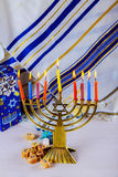 Jewish holiday Hanukkah with menorah over wooden table Stock Image