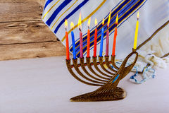 Jewish holiday Hanukkah with menorah over wooden table Royalty Free Stock Photography