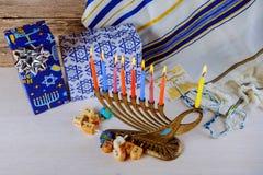 Jewish holiday Hanukkah with menorah over wooden table Stock Photo