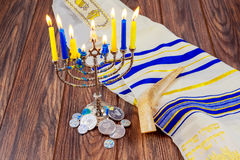 jewish holiday Hanukkah with menorah over wooden table Star David Stock Photography