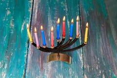 Jewish holiday Hanukkah with menorah tallit traditional. Jewish holiday jewish holiday Hanukkah with menorah traditional Candelabra and wooden dreidels spinning Royalty Free Stock Image