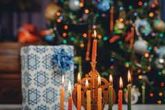Jewish holiday Hanukkah with menorah traditional candelabra and Burning candles. Jewish holiday Hanukkah with menorah traditional candelabra burning candles stock photo