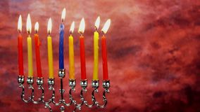Jewish holiday Hanukkah with menorah traditional Candelabra and wooden dreidels stock video footage