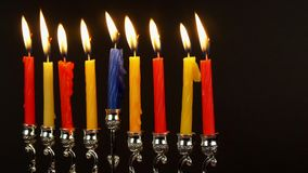 Jewish holiday Hanukkah with menorah traditional Candelabra and wooden dreidels stock video