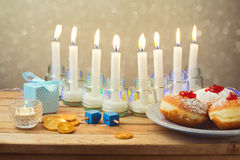 Jewish holiday Hanukkah table setting. Over blur background Royalty Free Stock Photography