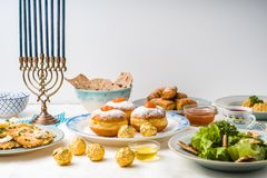 Jewish holiday Hanukkah, traditional feast side view royalty free stock images