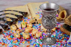 Hanukkah menorah of dreidels in rustic setting. Jewish holiday Hanukkah wine Hanukkah menorah with of Hanukkah dreidels in rustic setting Chanukah wooden Stock Image