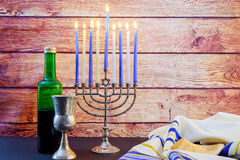 Jewish holiday Hanukkah wine taliit Beautiful menorah Stock Photos