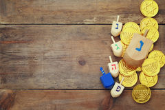 Jewish holiday Hanukkah with wooden dreidels. Image of jewish holiday Hanukkah with wooden dreidels colection (spinning top) and chocolate coins on the table