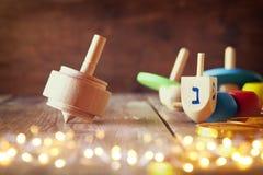 jewish holiday Hanukkah with wooden dreidels Stock Photo